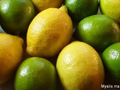 a bowl of limes and lemons